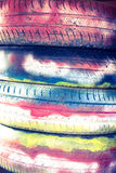 Tires are painted with colored paints for background. Close up d Royalty Free Stock Images