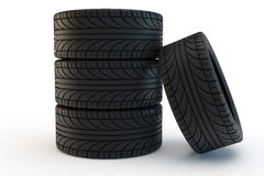 Tires. Pile of black car tires, one tire leans on a pile Stock Images