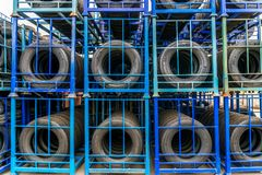 Tires on the rack in the warehouse Stock Photo