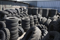 Tires In Recycling Centre. Stacked old tires in recycling center Stock Image