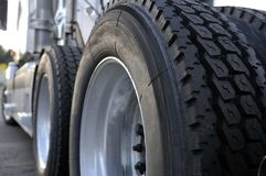 Big rig semi truck with huge wheels with tires. The tires and rims of big rig semi trucks are given great importance since trucks are the main means of royalty free stock image