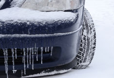 Tires on the road are covered with snow Royalty Free Stock Photos
