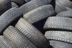 Car recycling tires rubber pollution environment industry. Tires rubber recycling stack dump car waste stock photo