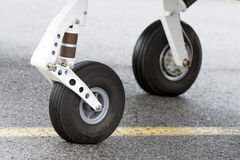 Tires of a small propeller airplane Stock Images