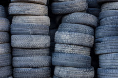 Tires in a stack. Suggesting used tire deposit Stock Photos