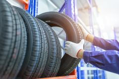 Tires in a tire store, Spare tire car, Seasonal tire change, Car maintenance and service center. Vehicle tire repair and stock photography