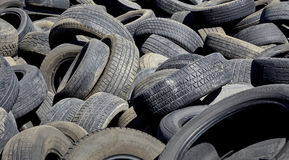 Tires used worn for recycling waste management industry disposal Stock Photos