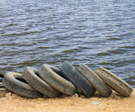 Tires with water waves Stock Images