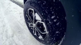 Tires, wheels driving through heavy snow. Slow motion. On board camera. stock video