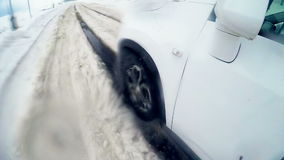 Tires, wheels driving through heavy snow. Slow motion. On board camera. stock video footage