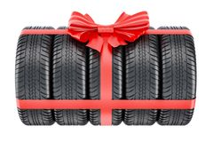 Tires wrapped ribbon and bow, gift concept. 3D rendering. On white background Royalty Free Stock Photography