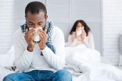 Unpleasant day of a young ill couple Stock Images