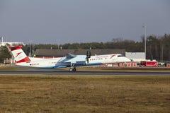 Tiret de bombardier d'Austrian Airlines d'†d'aéroport international de Francfort le «décolle Images libres de droits