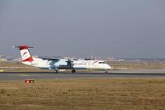 Tiret de bombardier d'Austrian Airlines d'†d'aéroport international de Francfort le «décolle Images stock