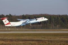 Tiret de bombardier d'Austrian Airlines d'†d'aéroport international de Francfort le «décolle Photographie stock