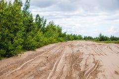 Tiretracks na areia Imagem de Stock