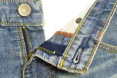 Tirette de jeans de denim Photo stock
