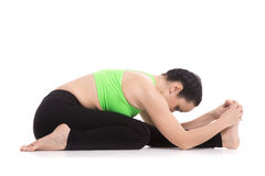 Tiriang Mukha Eka Pada Paschimottanasana yoga pose Royalty Free Stock Photography
