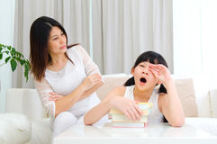 Tiring. Asian mother looking at her sleepy daughter Royalty Free Stock Photos