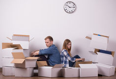 Tiring to pack up. Young couple is tired because of packing up Royalty Free Stock Photography