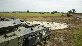 Tiro aéreo dos tanques em um campo vídeos de arquivo