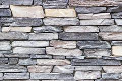 Tiro ancho delantero de la pared de piedra colorida destacada del rectángulo de la albañilería en Esmirna en Turquía con el estuc imagenes de archivo