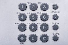 Tiro ascendente próximo da imagem tonificada do telefone teclado numérico cinzento foto de stock