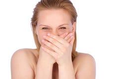 Tiro brilhante da mulher nova com mão perto de sua face fotos de stock