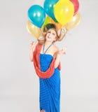 Tiro colorido de la muchacha adolescente con los globos Imagen de archivo