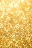 Fundo dourado de brilho Fotografia de Stock Royalty Free
