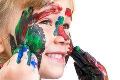Tiro de la cara de la cara pintada demostración del niño Imagen de archivo
