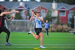 Tiro de las muchachas del lacrosse Imagen de archivo libre de regalías