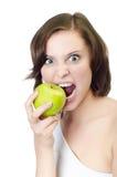 Tiro do estúdio. Mulher que prende o isolado verde da maçã Imagem de Stock Royalty Free
