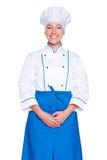 Tiro do estúdio do cozinheiro do smiley no uniforme Imagens de Stock Royalty Free