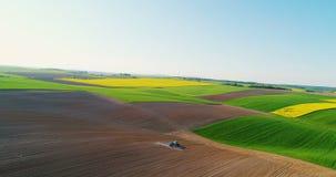 Drone shoot of tractor fertilizing soil. Stock Footage