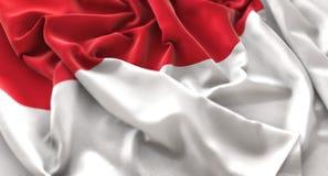 Tiro macro belamente de ondulação enrugado do close-up da bandeira de Mônaco fotos de stock