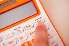 Tiro macro da calculadora do imposto Imagem de Stock