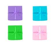 Tiro macro de 4 caixas de presente da cor Imagens de Stock