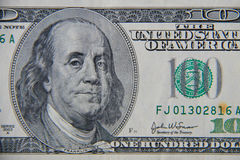 Tiro macro de cem dólares de conta Imagens de Stock Royalty Free