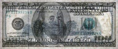 Tiro macro de 100 dólares Cuenta transparente Foto de archivo