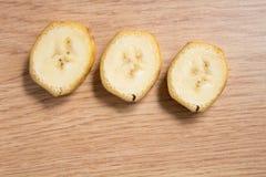 Tiro macro de três fatias da banana Fotos de Stock Royalty Free