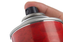 Tiro macro de uma mão masculina que guarda uma lata de pulverizador Imagens de Stock
