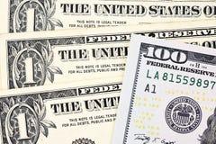 Tiro macro de umas 100 notas de dólar nova e de um dólar Imagem de Stock Royalty Free