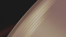 Tiro macro de una superficie giratoria rosada del disco de vinilo y de sus surcos de la pista