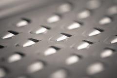 Tiro macro do monocrome detalhado de um ralador do queijo do metal fotos de stock