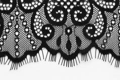 Tiro material de la macro de la textura del cordón negro de las flores Imágenes de archivo libres de regalías