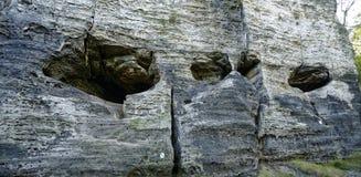 Tiro próximo dos furos na rocha Fotografia de Stock