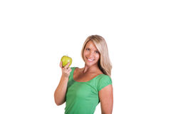 Tiro principal da mulher que mantém a maçã contra o fundo branco Fotos de Stock Royalty Free