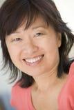 Tiro principal de la sonrisa de la mujer Imagen de archivo libre de regalías