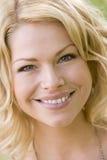 Tiro principal do sorriso da mulher Fotografia de Stock Royalty Free